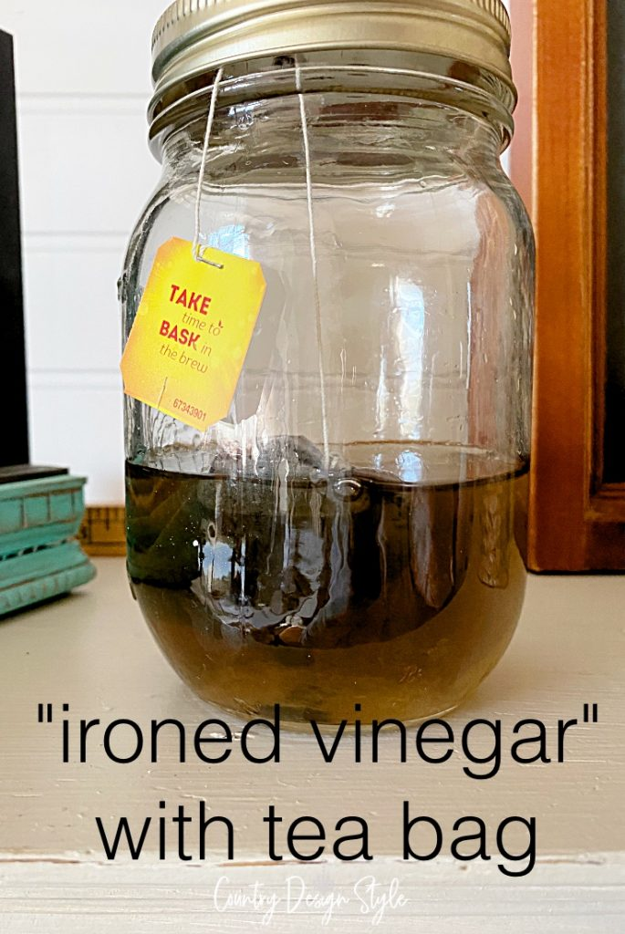 mason jar with ironed vinegar and teabag