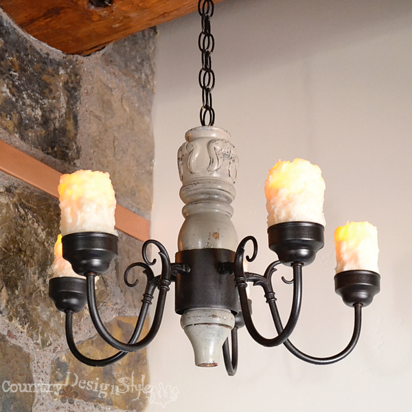 hanging in place with #batterycandles https://countrydesignstyle.com #DIY #chandelier #candlechandelier
