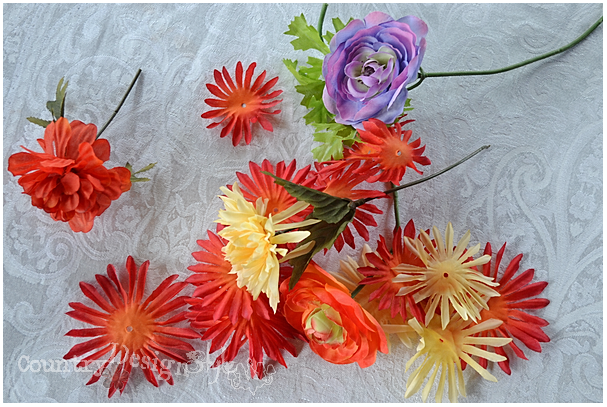 pile of old silk flowers http://countrydesginstyle.com #silkflowers #tablescapes #simplepartyideas