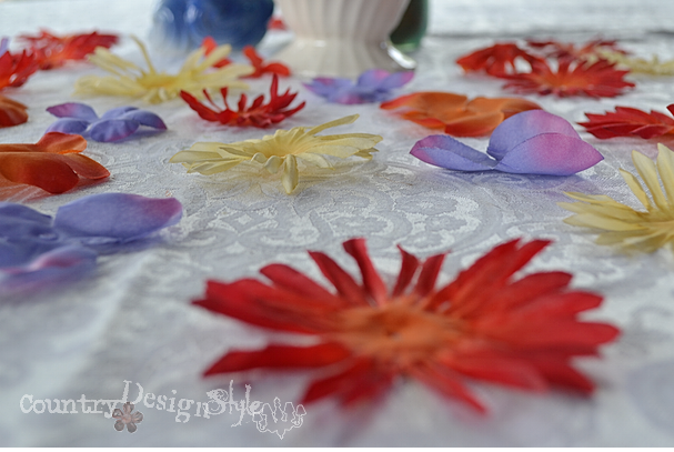 scattered petals http://countrydesginstyle.com #silkflowers #tablescapes #simplepartyideas