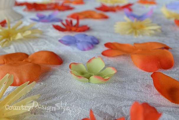 close up of scattered flowers http://countrydesginstyle.com #silkflowers #tablescapes #simplepartyideas