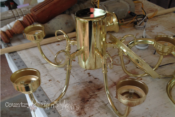 stripped chandelier http://countrydesignstyle.com #DIY #chandelier #candlechandelier