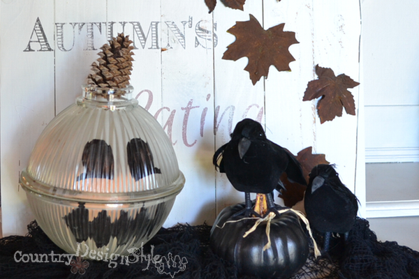 pumpkin from chandelier globe https://countrydesignstyle.com #pumpkin #fall