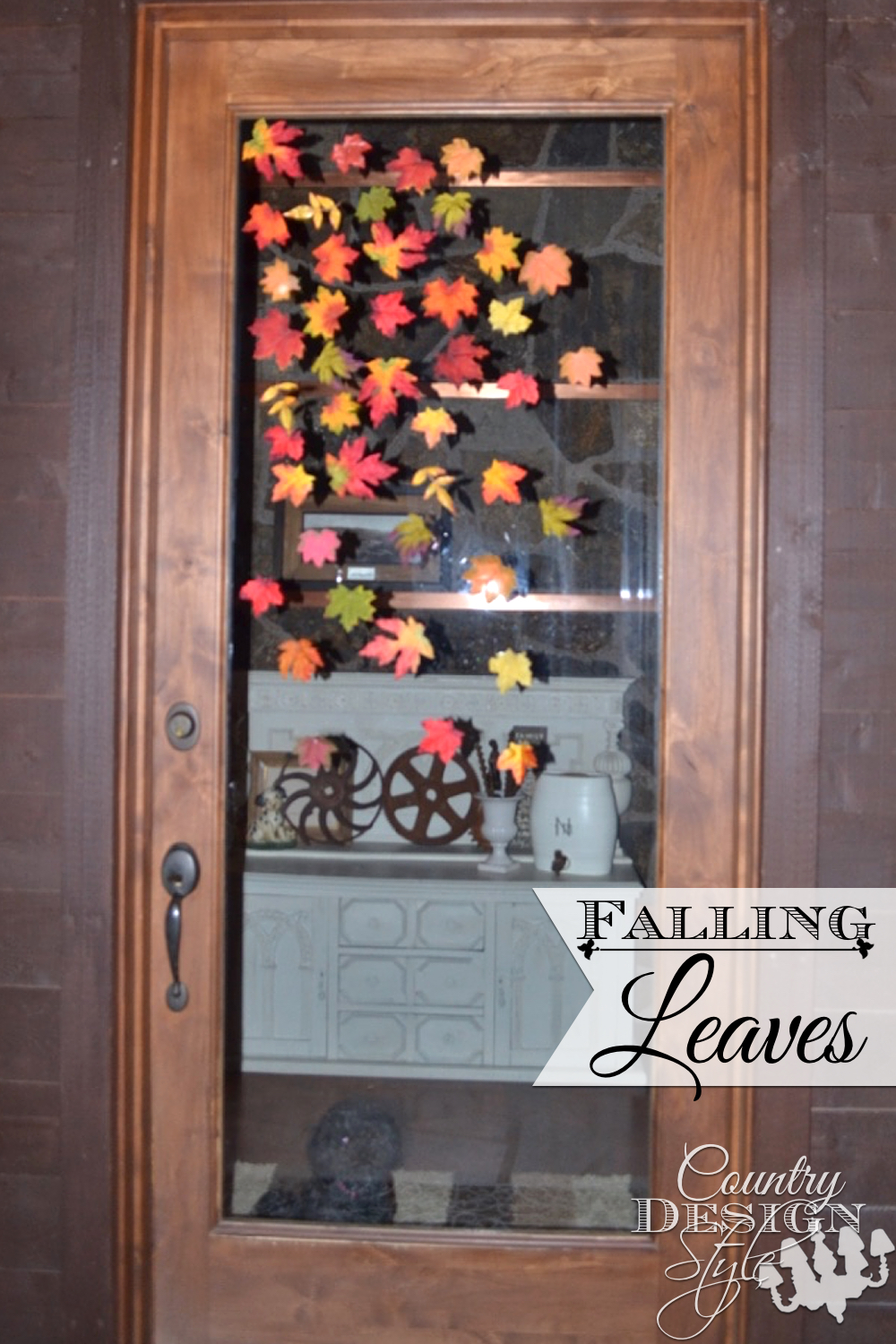 Do you dare to hot glue silk leaves to your glass door? I did this early fall decor with the leaves in the bottom of the fall decor crate. Country Design Style www.countrydesignstyle.com