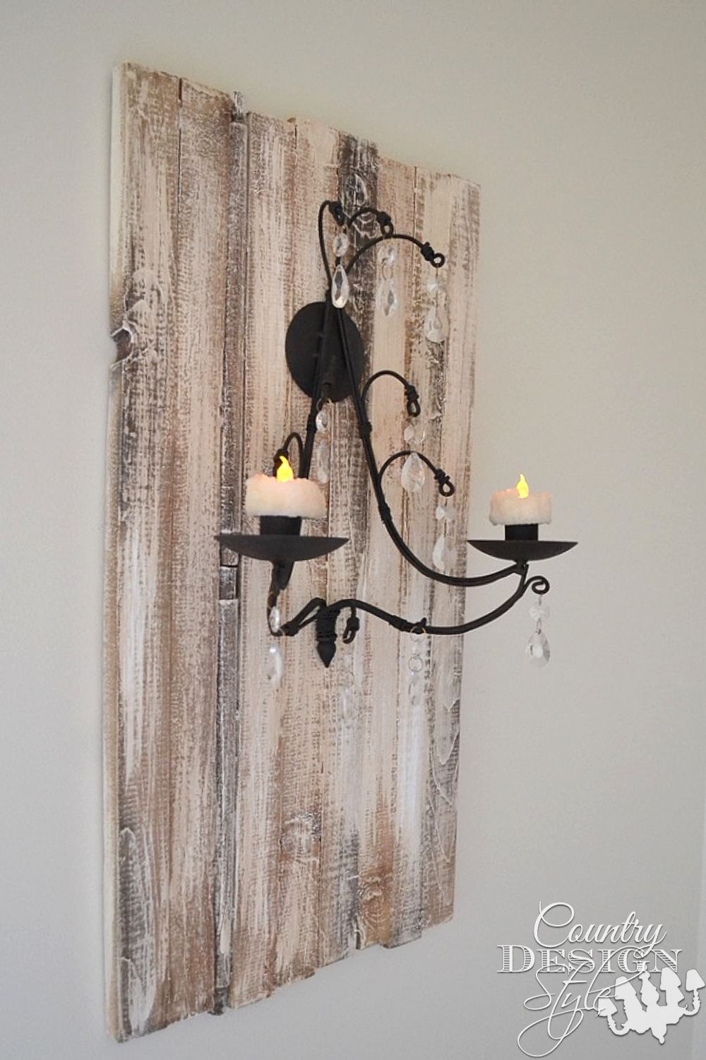 Rustic plaque made from wood planks add importance to simple candle sconce. Country Design Style