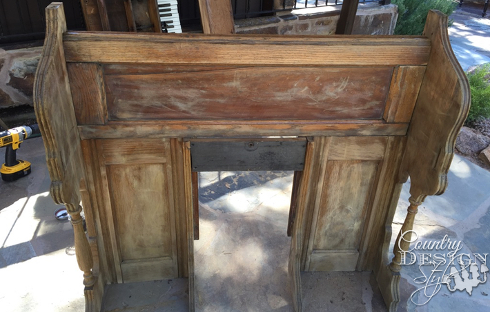 Pieces of an old organ turning into a faux mantel. | countrydesignstyle.com