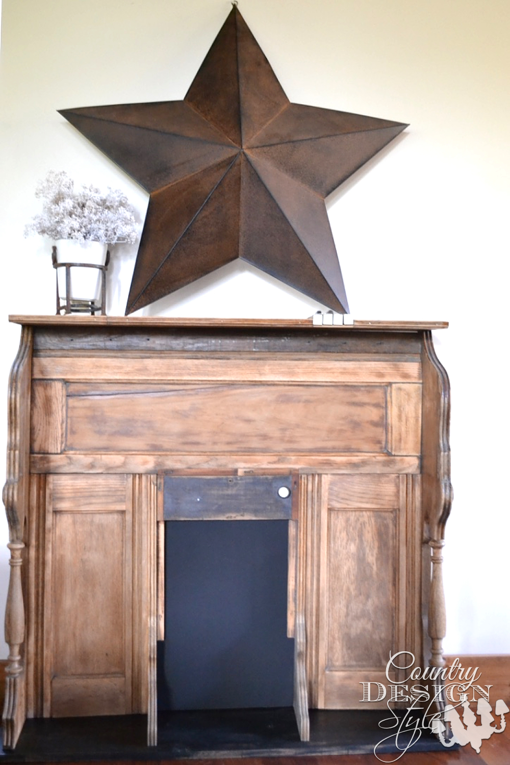 Organ makeover into faux mantel decorated with large metal star and vase of babies breath. The firebox area is CHALKBOARD. PIANO or ORGAN KEYS are designed into the top. | countrydesignstyle.com