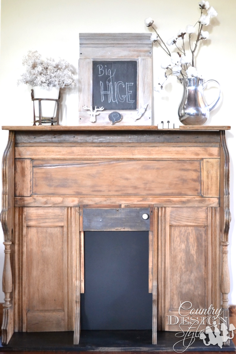 Organ remade into faux mantel with tutorial for inserting piano keys into top, chalkboard in firebox. Displayed with DIY cotton stems.   countrydesignstyle.com