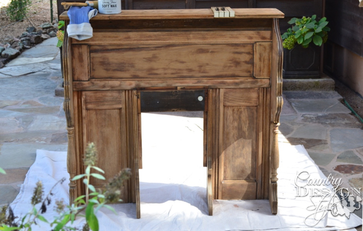Pieces of an old organ turning into a faux mantel. The wood was waxed to clean and perserve | countrydesignstyle.com