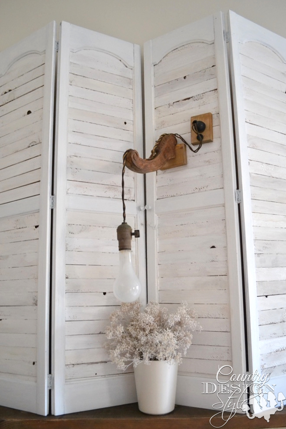 Vintage Styled Lighting. Not great to read by, but a fun prop. Wooden bracket and cloth cord.   countrydesignstyle.com