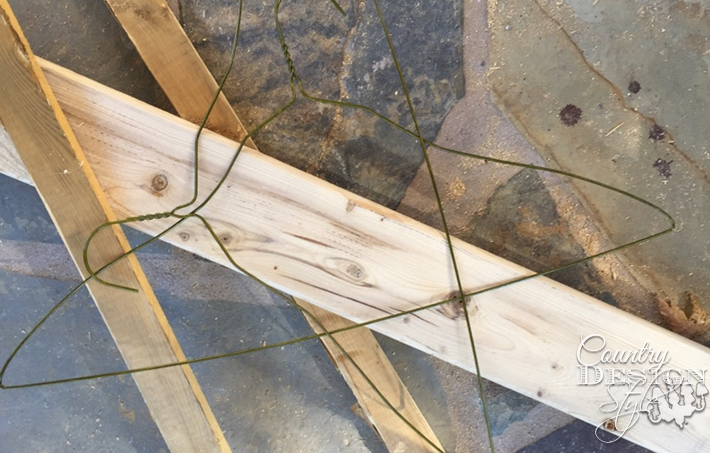 Scrap boards and wire hangers are used to make a scrap wood stacked Christmas Tree. Easy DIY   countrydesignstyle.com