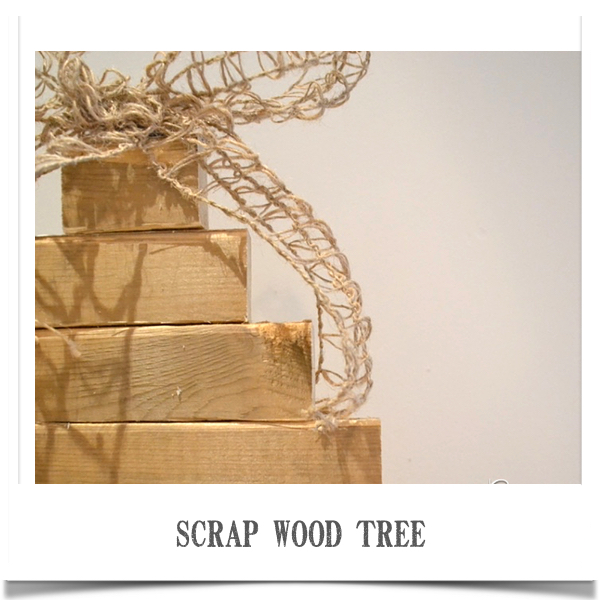 Using scrap wood pieces to make a stacked christmas tree with burlap bow.   countrydesignstyle.com