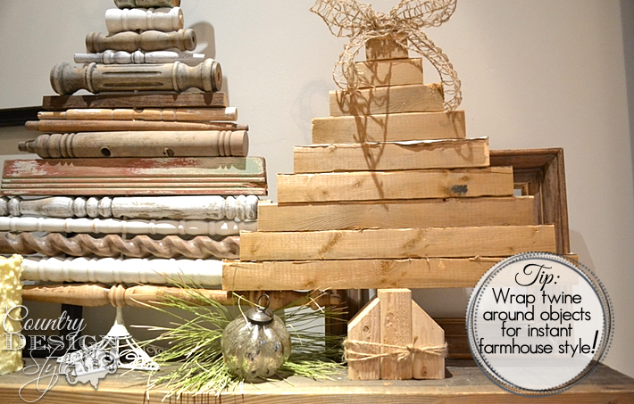 Using scrap wood pieces to make a stacked planked christmas tree with burlap bow.   countrydesignstyle.com