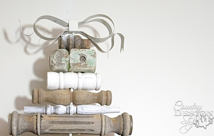 Christmas tree in vintage style made with old spindles the metal ribbon bow. | countrydesignstyle.com