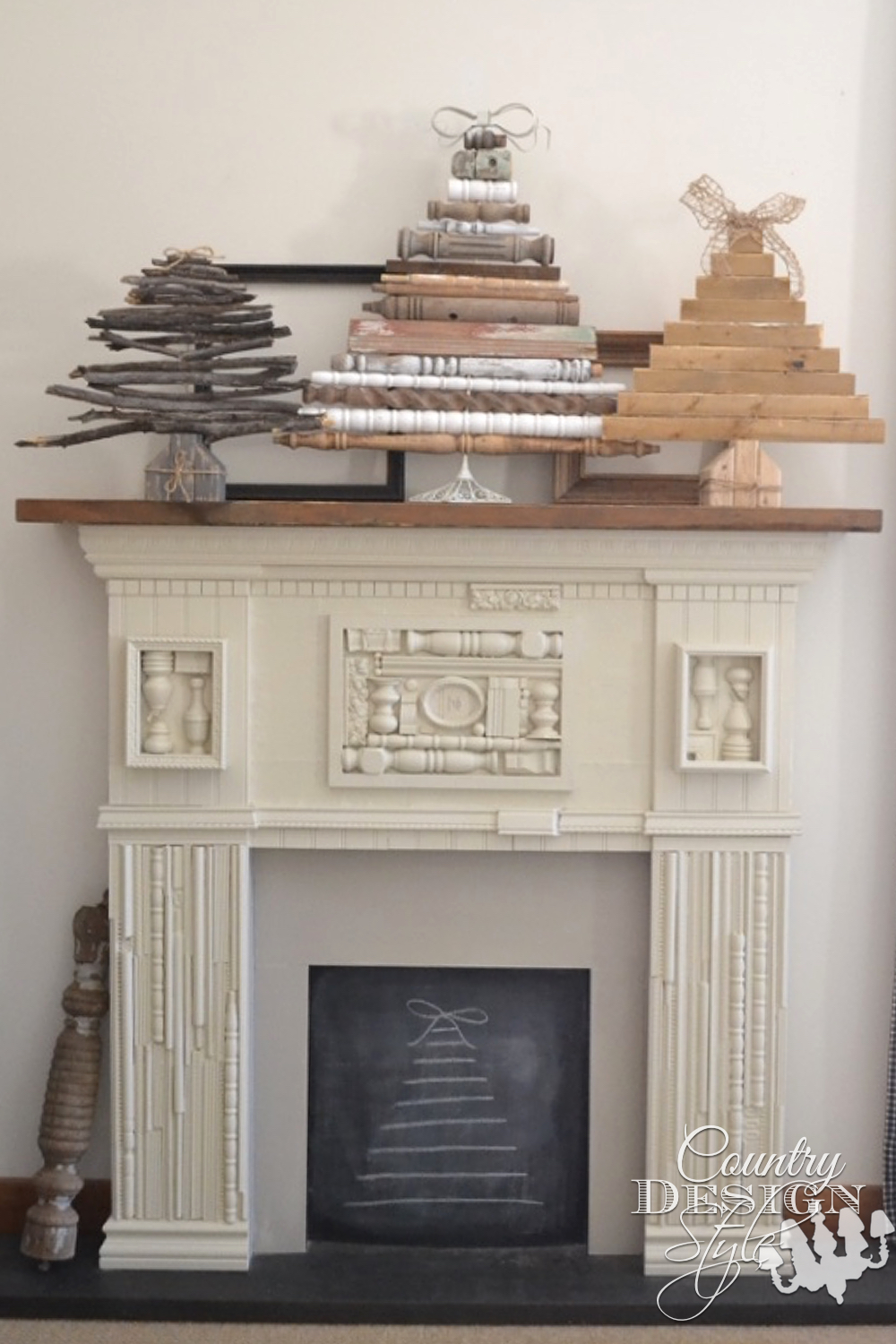 Scrap wood mantel with planked style Christmas tree even on the chalkboard firebox area. | countrydesignstyle.com