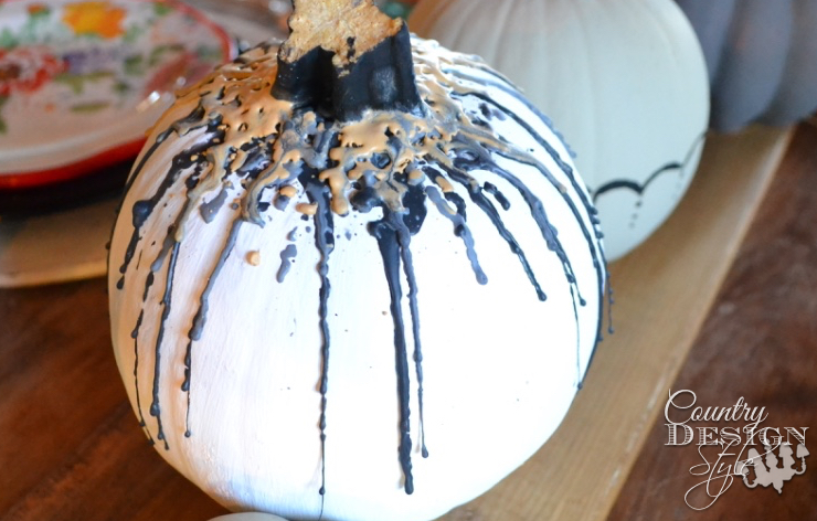 Pumpkin with melted crayon in fall colors to display on Thanksgiving table.   countrydesignstyle.com