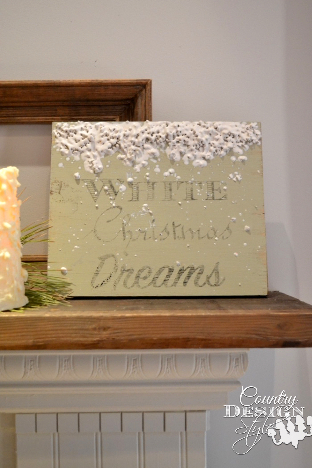 Scrap wood made into Christmas sign with chalk based paint, image transfer, and melting crayon art for melting snow. | countrydesignstyle.com