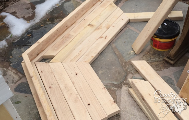 Laying out top of garden bench | Country Design Style | countrydesignstyle.com