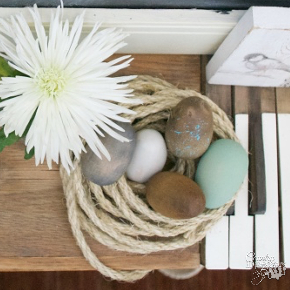 Eggs in rope nest on Easter Mantel | Country Design Style | countrydesignstyle.com