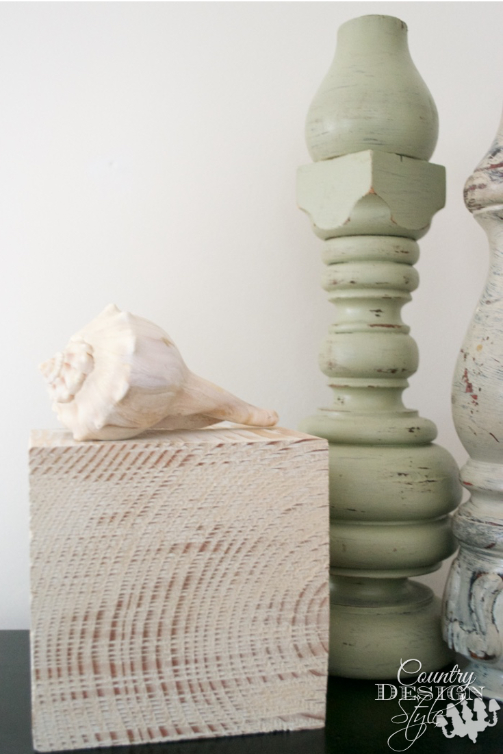 Seashell is special placed on decorative wood block | Country Design Style | countrydesignstyle.com