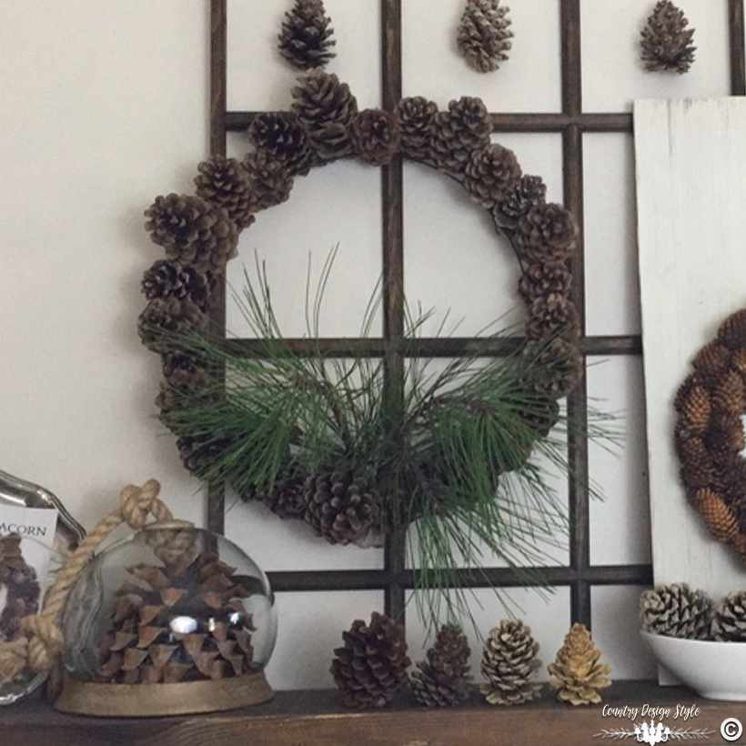 blooming-pine-cone-wreath-on-window-frame-country-design-style-countrydesignstyle-com