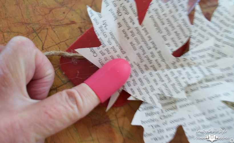 book-page-leaves-gluing-on-twine-country-design-style-countrydesignstyle-com