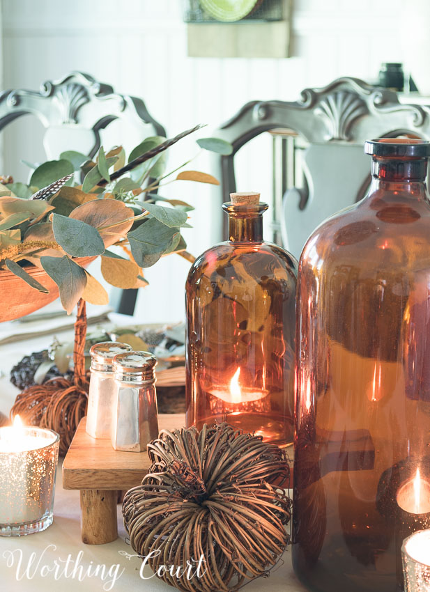 brown-glass-jugs-on-a-fall-table