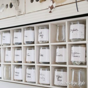 Cubbies filled with jars and labeled