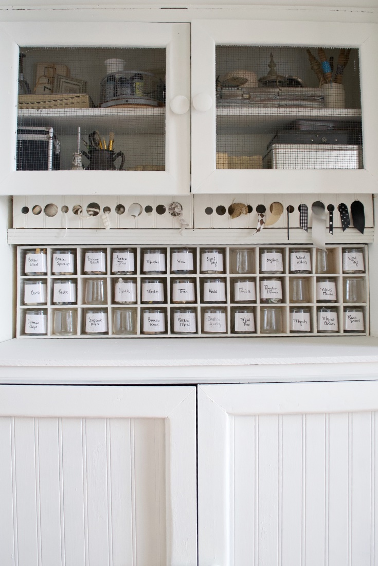 Craft cabinet filled with cubbies and supplies
