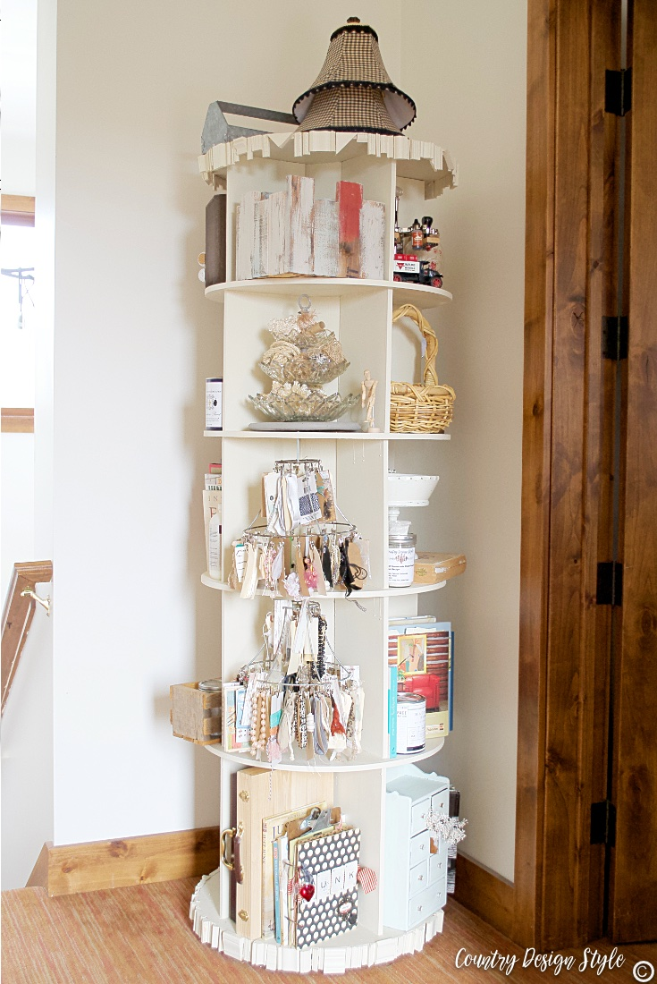 Revolving bookcase filled with craft supplies