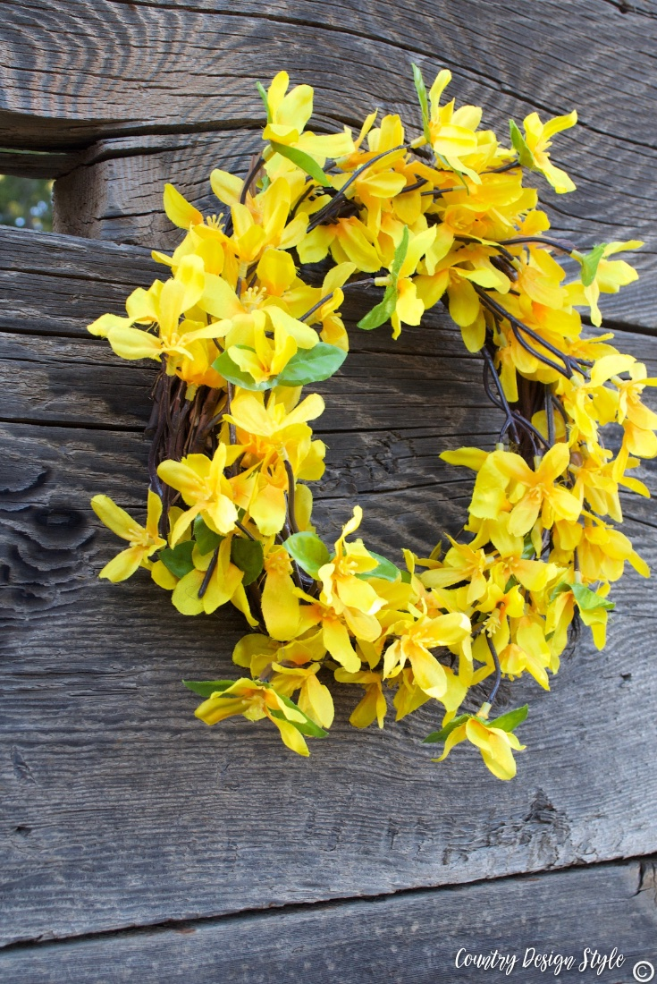 Spring wreath for front door finished on fence |