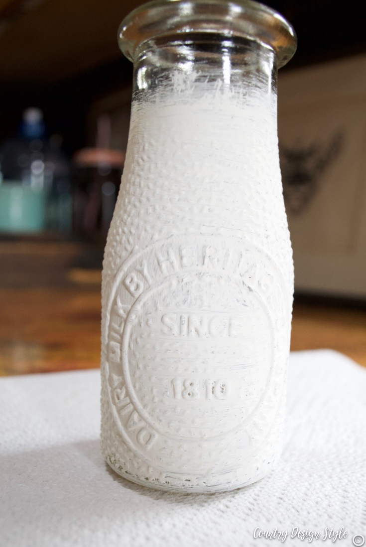 Rustic wedding centerpiece milk bottle painted