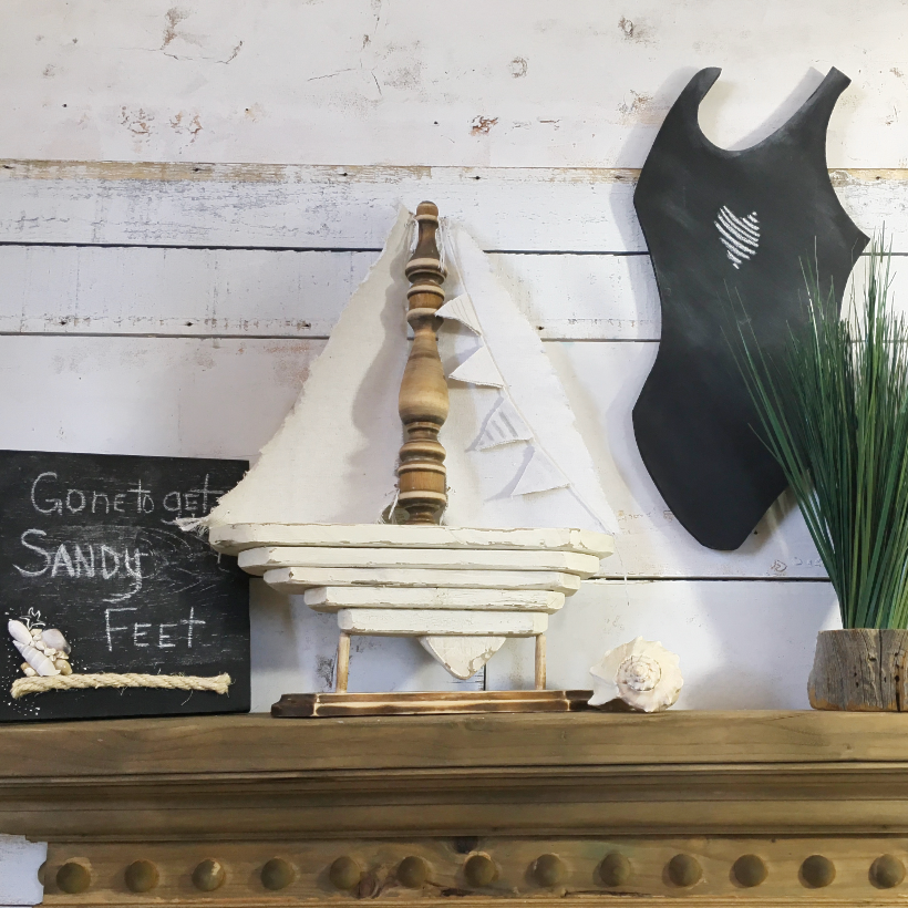 Nautical display on the mantel with chalkboard swimsuit
