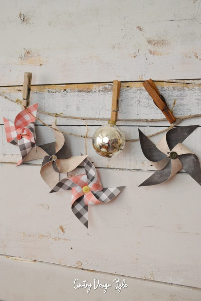 Paper Pinwheel Ornaments hanging from stick