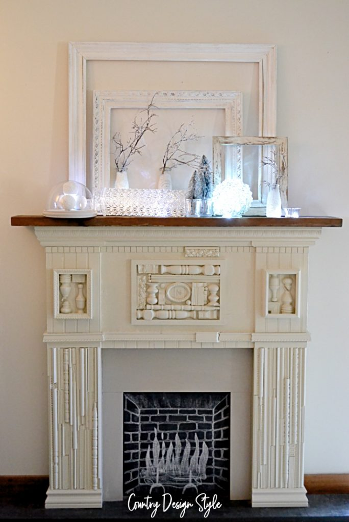 battery operated lights on mantel vignette