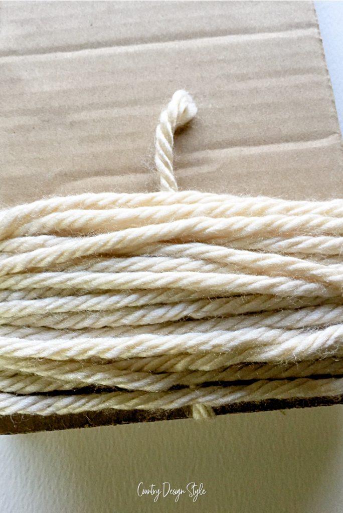 Center yarn on back of cardboard