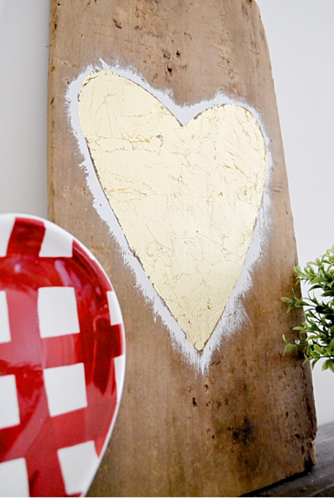 Reclaimed barn wood heart on mantel