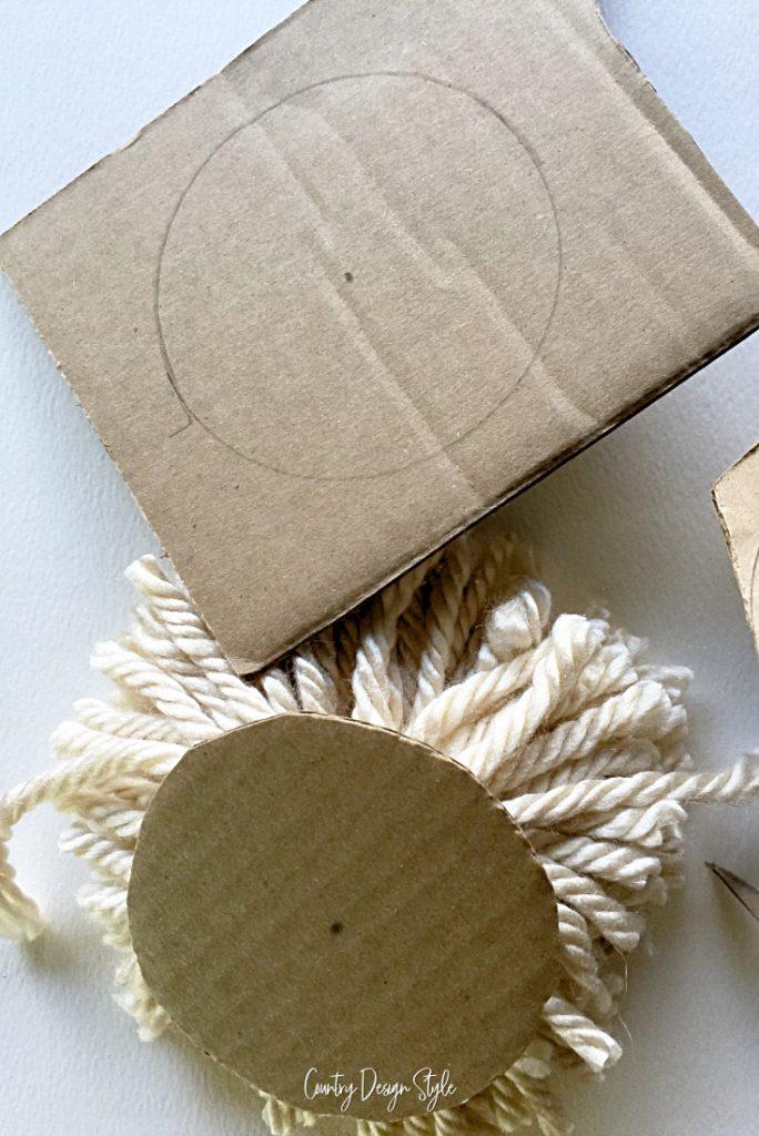 The cardboard pom pom maker