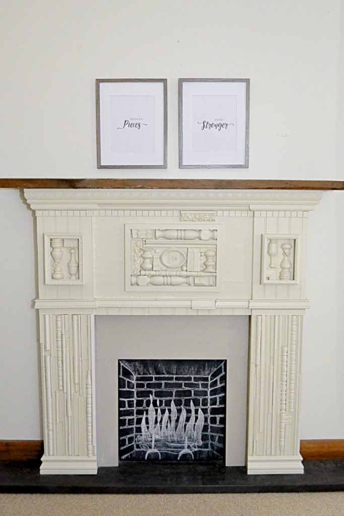 Two frames hanging about scrap wood mantel with modern farmhouse printables.
