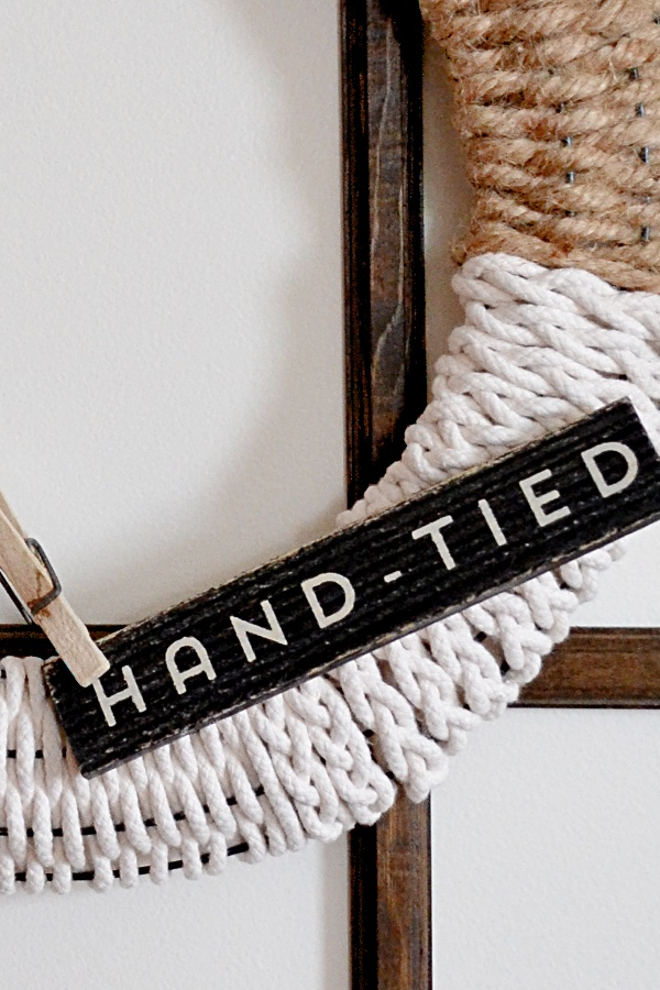 Image of wire wreath frame close up the hand-tired wood sign.