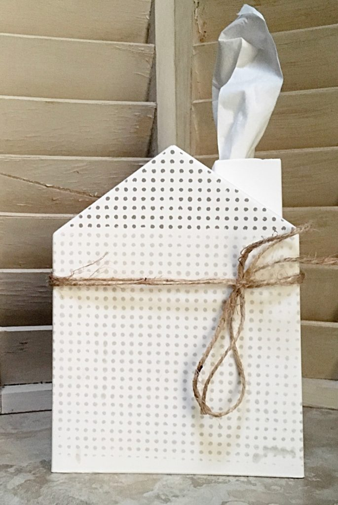 white tissue cover with farmhouse dot style and twine.