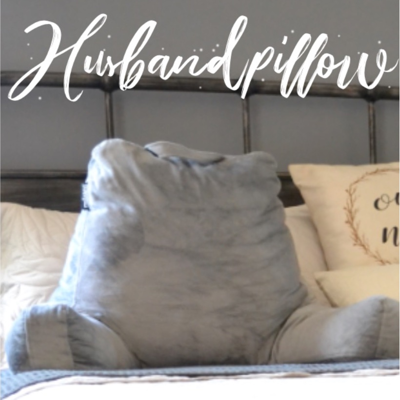 Gray husband pillow sitting on bed
