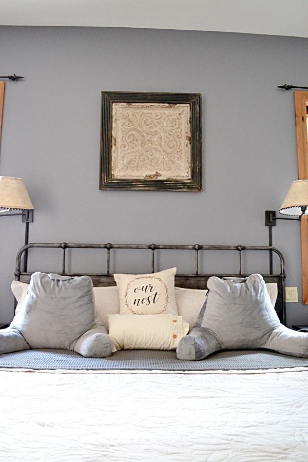 king size bed with two gray pillows