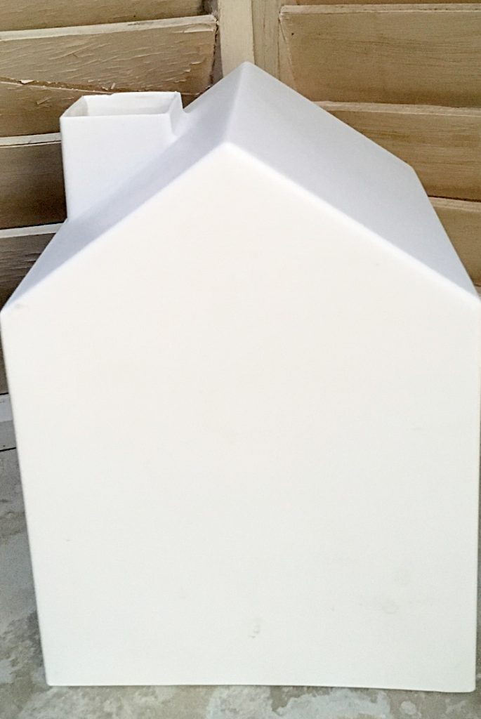 plain white plastic tissue box cover in the shape of a house with a chimney.