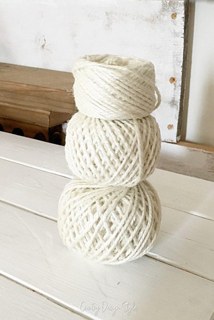 yarn balls stacked like a snowman