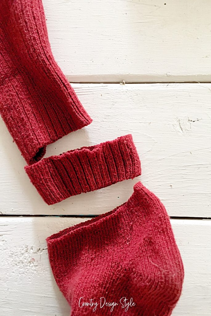 red sock cut into three pieces