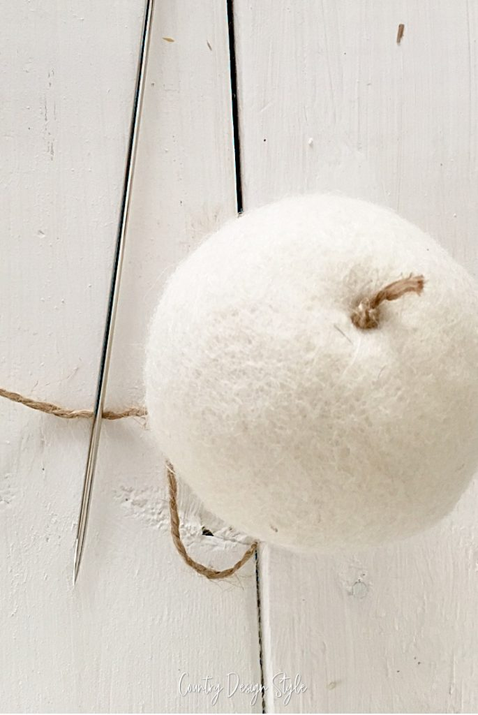 twine through wool dryer ball