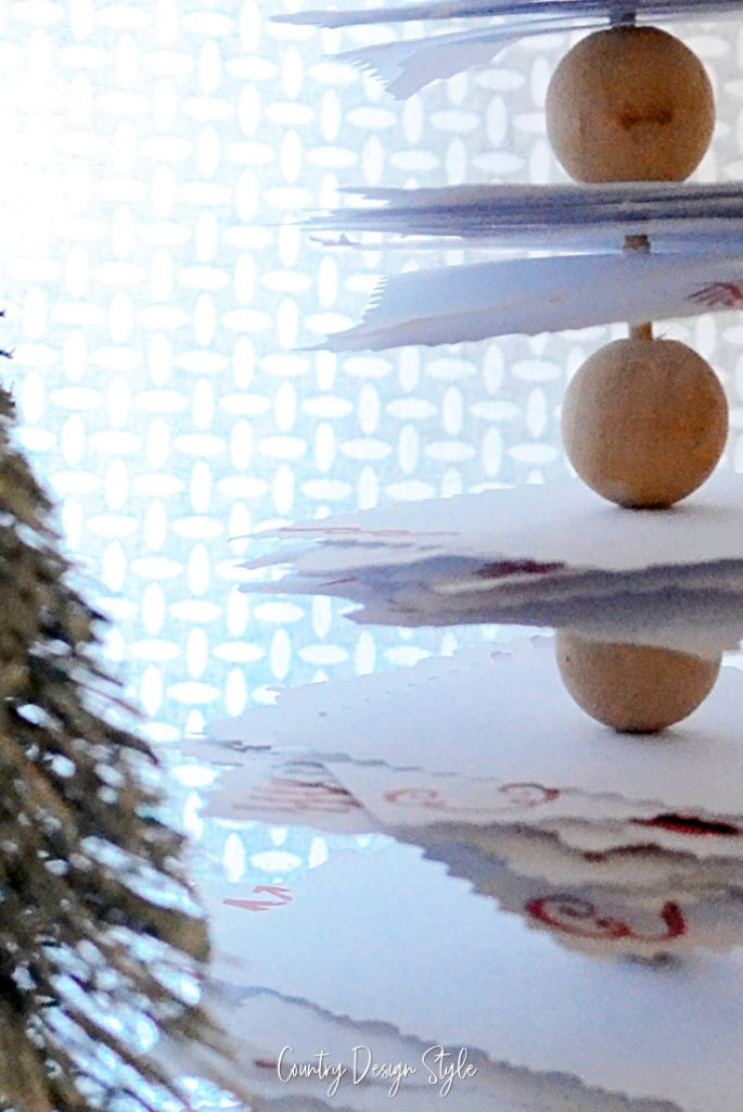 close up of wood beads in paper tree