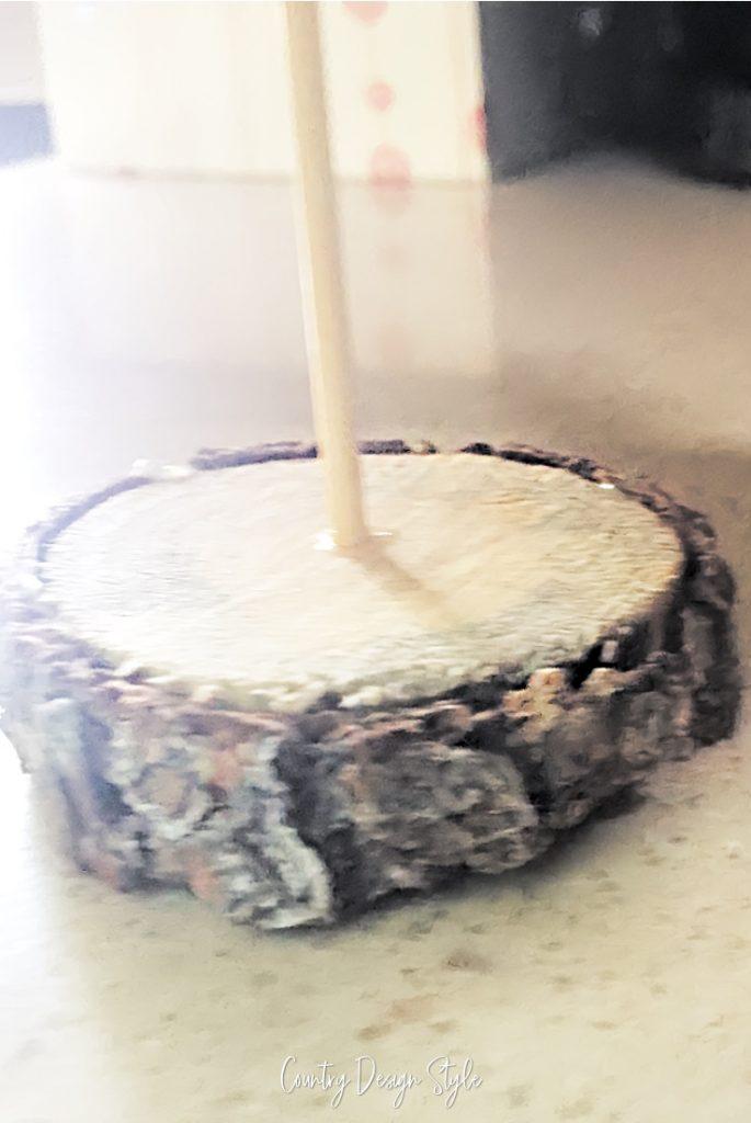 wood slice with skewer.