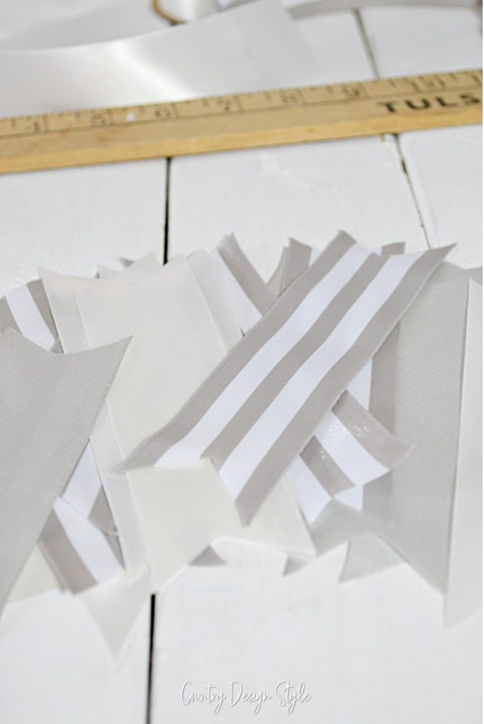 nine pieces of ribbon with v shaped ends